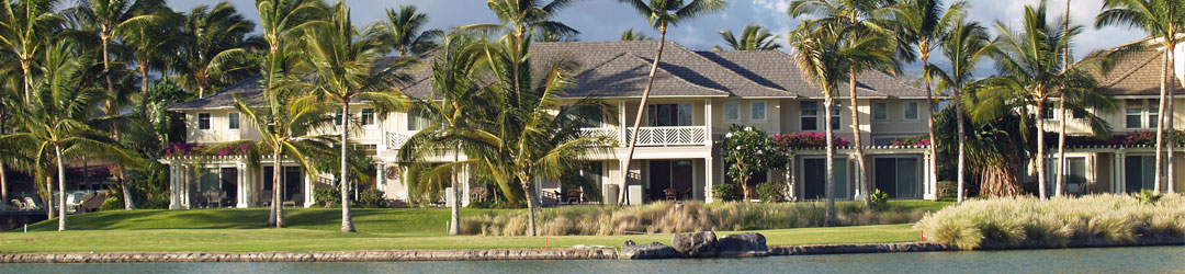 Beautiful photo of the exterior of a large house facing the ocean