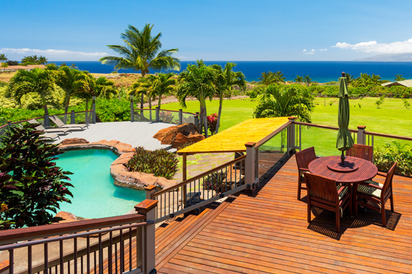 Shot from the stairs leading down to lanai and pool with oceanview backddrop